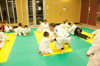Small Kids Training Breaking Of Balance Form Knees
